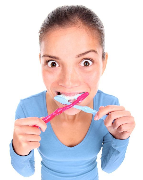 woman brushing her teeth too much